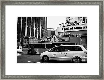 Gray Line New York Sightseeing Bus And Yellow Mpv Taxi Cab On 7th Avenue New York City Framed Print by Joe Fox
