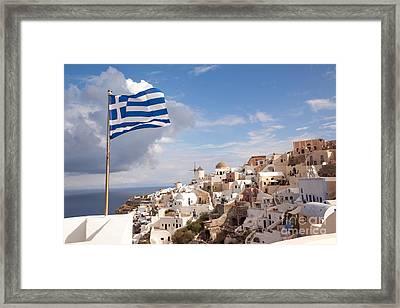 Greek National Flag Waving Over Oia - Santorini - Gr Framed Print by Matteo Colombo
