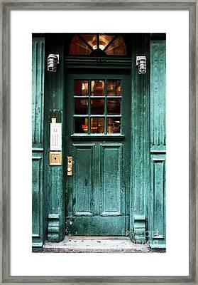 Green Door In The Village Framed Print by John Rizzuto