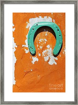 Green Horseshoe Decorating Orange Wall Framed Print by Sami Sarkis