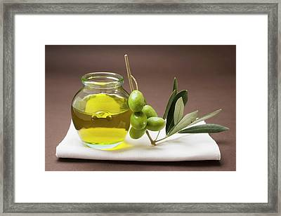 Green Olives On Twig Beside Jar Of Olive Oil Framed Print