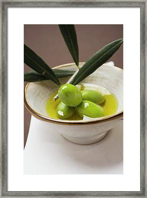 Green Olives On Twig In Bowl Of Olive Oil Framed Print