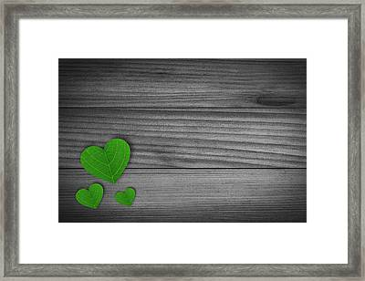 Green Pedal Shaped Hearts Framed Print by Aged Pixel