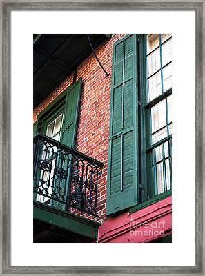 Green Shutters In The Quarter Framed Print by John Rizzuto