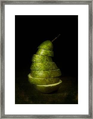 Green Sliced Pear Framed Print by Jaroslaw Blaminsky