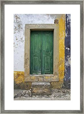 Green Wood Door With Hand Carved Stone Against A Texured Wall In The Medieval Village Of Obidos Framed Print by David Letts