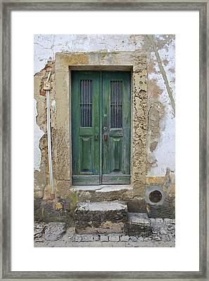 Green Wood Door With Hand Carved Stone In The Medieval Village Of Obidos Framed Print by David Letts