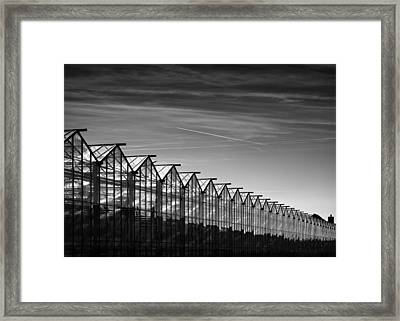 Greenhouses And Vapour Trails Framed Print by Dave Bowman
