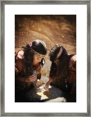 Grinding Corn Framed Print by Betty Depee