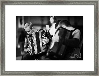 Group Of Accordion Players During Street Performance In Rynek Glowny Town Square Krakow Framed Print