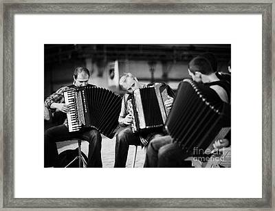 Group Of Accordion Players Perform In The Street In Rynek Glowny Town Square Krakow Framed Print