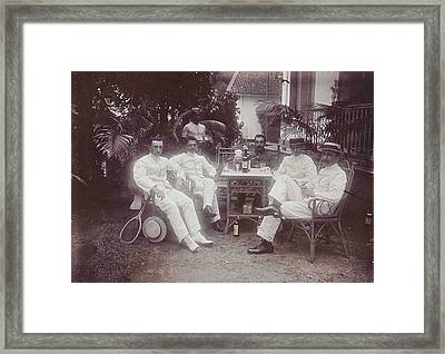 Group Of Men At The Table In Front Of The Porch Is Verved Framed Print