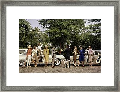 Group Of Models Posing In Front Of Cars Framed Print