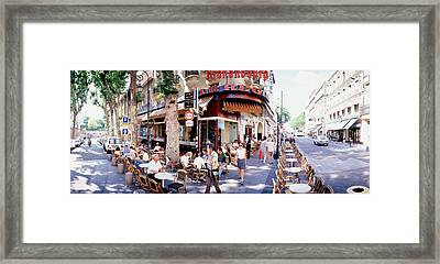 Group Of People At A Sidewalk Cafe Framed Print by Panoramic Images