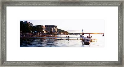 Group Of People At A Waterfront, Lake Framed Print by Panoramic Images