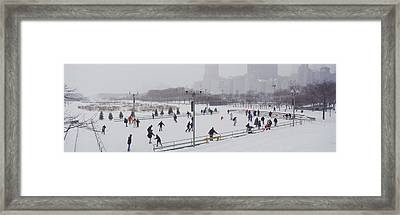 Group Of People Ice Skating In A Park Framed Print by Panoramic Images