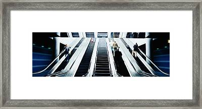 Group Of People On Escalators At An Framed Print by Panoramic Images