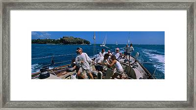 Group Of People Racing In A Sailboat Framed Print