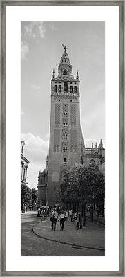 Group Of People Walking Near A Church Framed Print
