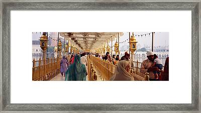 Group Of People Walking On A Bridge Framed Print by Panoramic Images