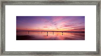 Group Of People Watching The Sunset Framed Print by Panoramic Images