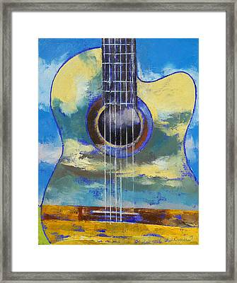 Guitar And Clouds Framed Print by Michael Creese