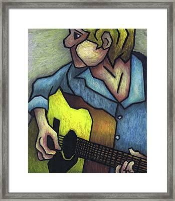 Guitar Man Framed Print by Kamil Swiatek
