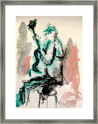 Guitar Player Seated Framed Print by James Gallagher