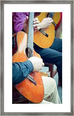 Guitar Players Framed Print by Mesha Zelkovich