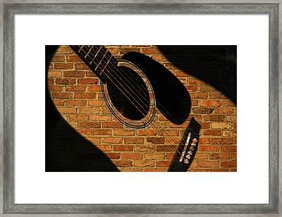 Guitar Shadow Framed Print