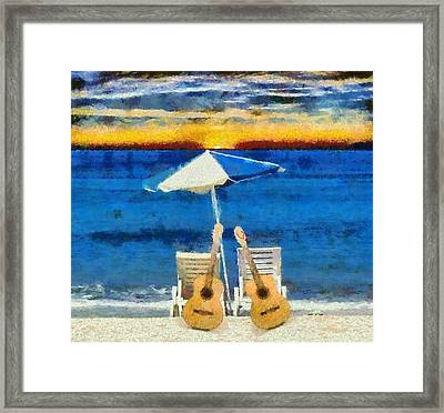 Guitars On The Beach At Sunset Framed Print by Dan Sproul