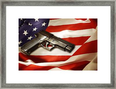 Gun On Flag Framed Print by Les Cunliffe