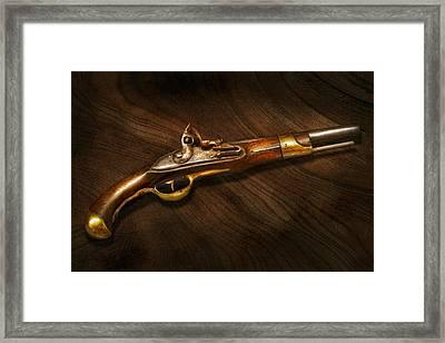 Gun - Pistols At Dawn Framed Print by Mike Savad
