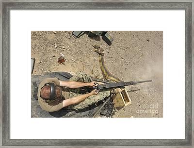 Gunners Mate Fires An M2 .50-caliber Framed Print by Stocktrek Images