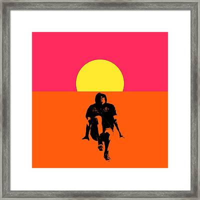 Guy Floating On Background Of Sunset Framed Print