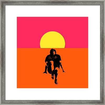 Guy Floating On Background Of Sunset Framed Print
