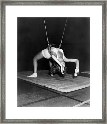 Gymnasium Harness Workout Framed Print by Underwood Archives