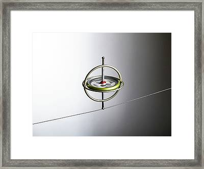 Gyroscope Balancing On A Wire Framed Print by Science Photo Library