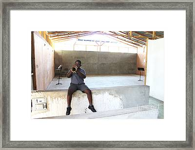 Haitian Boy Plays Trumpet Framed Print by Jim Wright