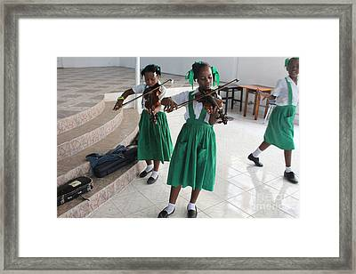 Haitian Girls Play Violins Framed Print by Jim Wright
