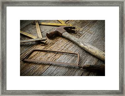 Hammer Saw And Measuring Tape On Rustic Wood Background Framed Print