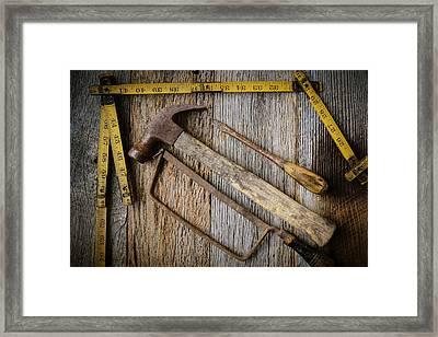 Hammer Saw Screwdriver And Measuring Tape On Rustic Wood Backg Framed Print