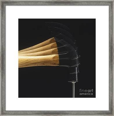 Hammer Striking A Nail Framed Print