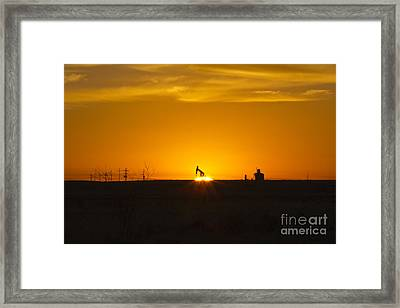Hammering The Sun Framed Print
