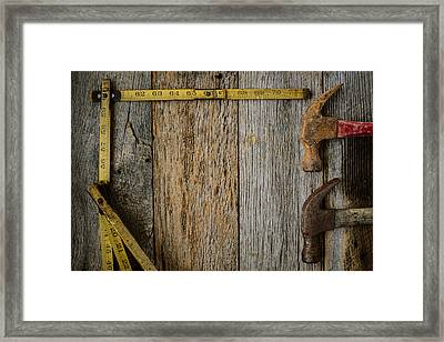 Hammers And Measuring Tape On Rustic Old Wood Background Framed Print