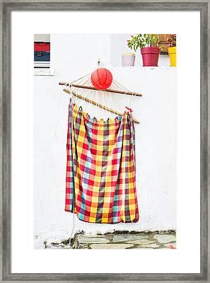 Hammock Framed Print by Tom Gowanlock