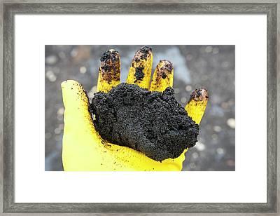 Hand Full Of Tar Sand Framed Print