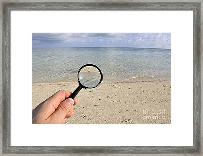 Hand Holding A Magnifying Glass Framed Print