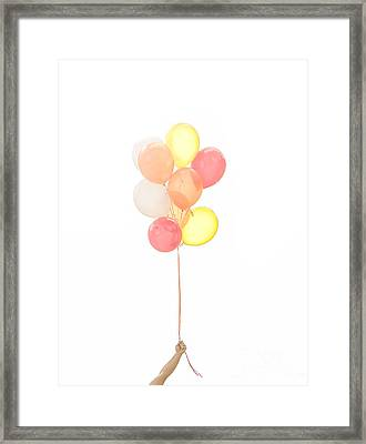 Hand Holding Balloons Framed Print by Diane Diederich