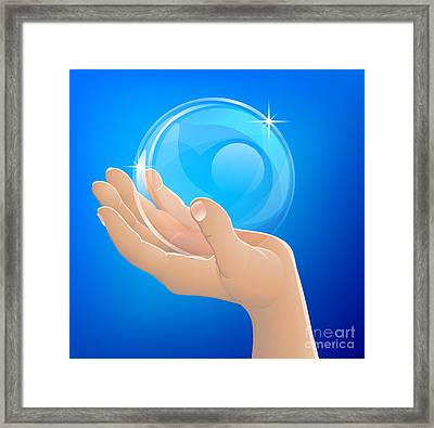 Hand Holding Bubble Or Glass Ball Framed Print